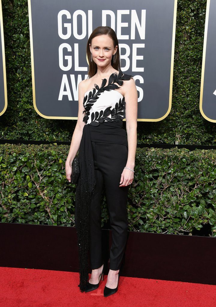 Alexis Bledel, known for Gilmore Girls, is wearing an Oscar de la Renta Dress with Jimmy Choo heels. A full sample sale look!